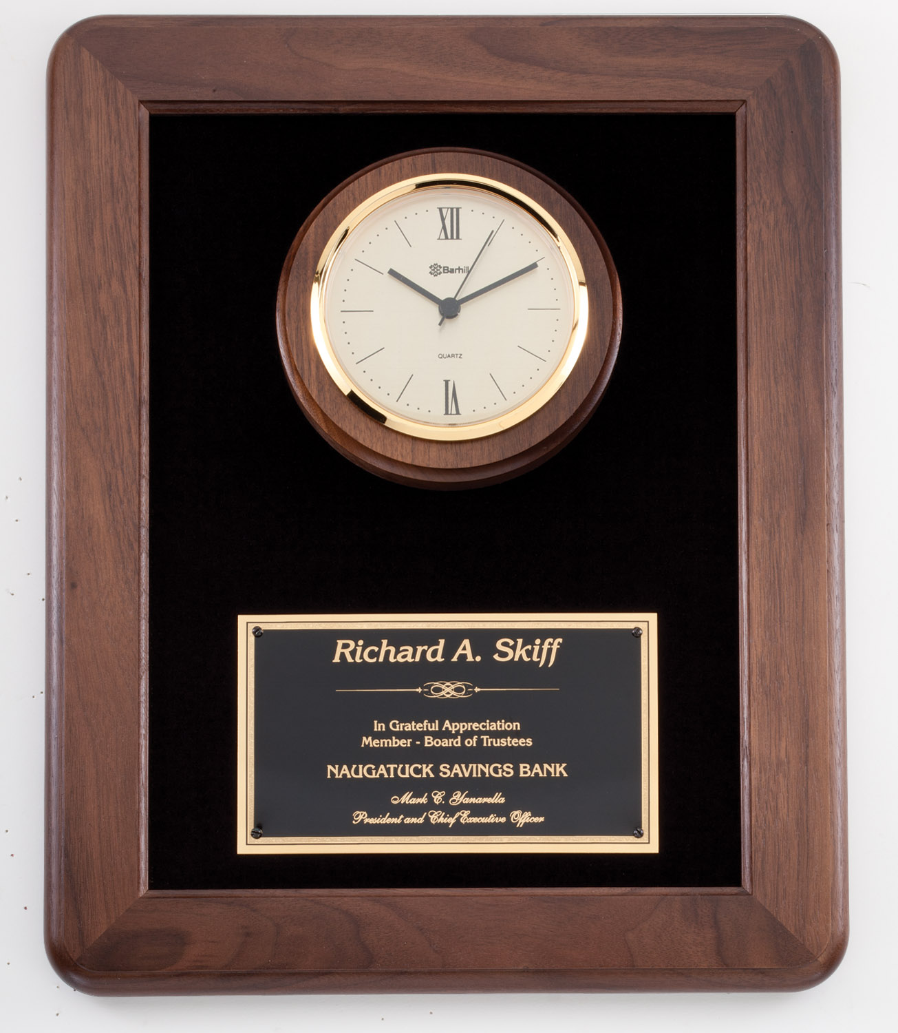 Walnut frame clock with black velour background